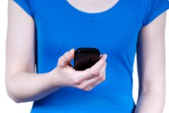 Woman holding a smartphone Stock Images