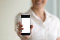 Woman holding smartphone, mockup screen for mobile ads, copy spa royalty free stock image