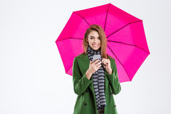 Woman holding smartphone under umbrella Stock Image