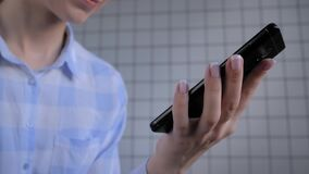 Woman holding smartphone and using voice recognition function - close up view
