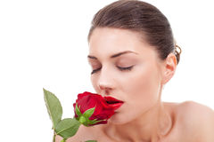 Woman holding and smelling red rose Royalty Free Stock Photography