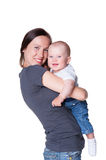 Woman holding smiley little boy Stock Photo