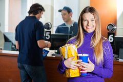 Woman Holding Snacks While Man Buying Tickets At Royalty Free Stock Photo