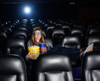 Woman Holding Snacks While Watching 3D Movie At Royalty Free Stock Photos