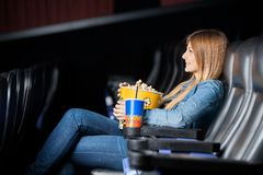 Woman Holding Snacks While Watching Film At Stock Photos
