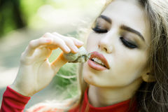 Woman holding snail near face Stock Photos