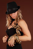 Woman holding a snake Royalty Free Stock Photos