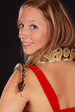 Woman holding a snake Royalty Free Stock Image