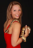 Woman holding a snake Royalty Free Stock Images