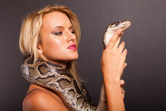 Woman holding snake Royalty Free Stock Photos