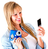 Woman holding a snapshot Royalty Free Stock Images
