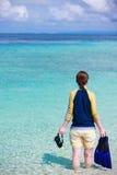 Woman holding snorkeling equipment Stock Photos