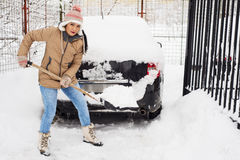 Woman holding snow shovel Royalty Free Stock Photography