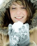 Woman holding snowball Royalty Free Stock Image