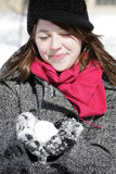 Woman holding snowball Royalty Free Stock Photos