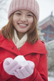 Woman Holding snowball outside in park stock photos