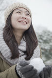 Woman Holding snowball outside in park Royalty Free Stock Photos