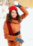 Woman holding a snowball Royalty Free Stock Photo
