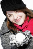 Woman holding snowball smiling Royalty Free Stock Photography