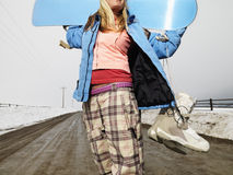 Woman holding snowboard. Stock Photo