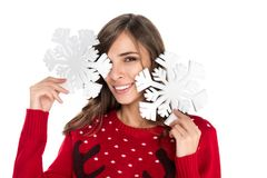 Woman holding snowflakes. Portrait of smiling woman holding decorative snowflakes isolated on white Royalty Free Stock Photos