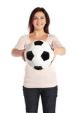 Woman holding a soccer ball Royalty Free Stock Image