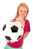 Woman holding soccer ball Stock Photo