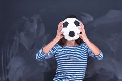 Woman holding a soccer ball in front of chalk drawing board Royalty Free Stock Photos
