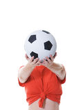 Woman holding soccer ball in front of face Stock Photos