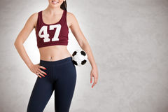 Woman Holding a Soccer Ball Stock Image