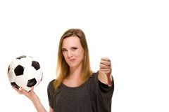 Woman holding a soccer ball showing thumbs down Royalty Free Stock Photo