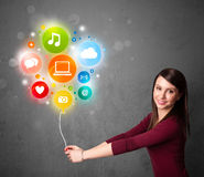 Woman holding social media balloon Stock Photography