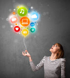 Woman holding social media balloon Royalty Free Stock Image