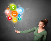 Woman holding social media balloon Royalty Free Stock Photo