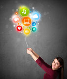 Woman holding social media balloon Stock Images