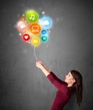 Woman holding social media balloon Stock Image