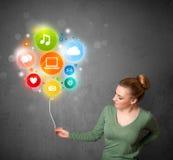 Woman holding social media balloon Stock Photos