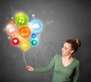 Woman holding social media balloon Stock Photography