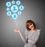 Woman holding social network balloon Stock Image