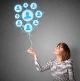 Woman holding social network balloon Stock Photos
