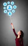 Woman holding social network balloon Royalty Free Stock Image