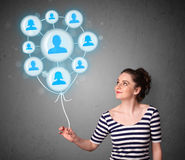 Woman holding social network balloon Stock Photos