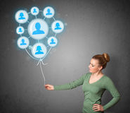 Woman holding social network balloon Royalty Free Stock Photography