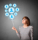 Woman holding social network balloon Royalty Free Stock Photo