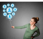 Woman holding social network balloon Stock Images