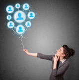 Woman holding social network balloon Royalty Free Stock Images