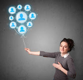 Woman holding social network balloon Royalty Free Stock Photos