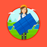 Woman holding solar panel. Royalty Free Stock Photo