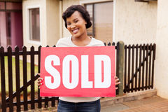 Woman holding sold sign Stock Photo
