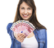 Woman holding some Euro currency notes. Beauitful woman holding some Euro currency notes, isolated over white background Stock Image